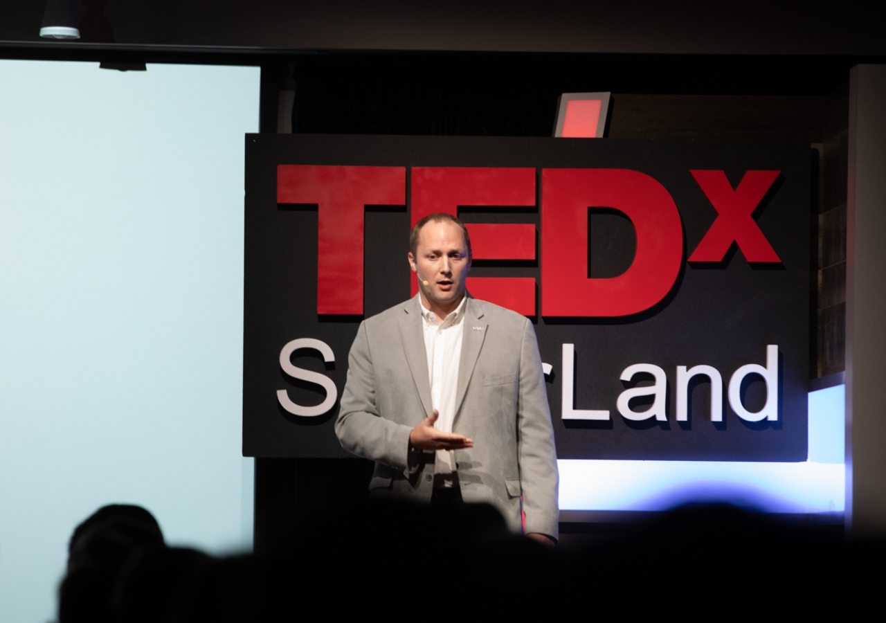 Kevin Doffing delivering his talk on How to Build a Community at TEDx SugarLand 2018.