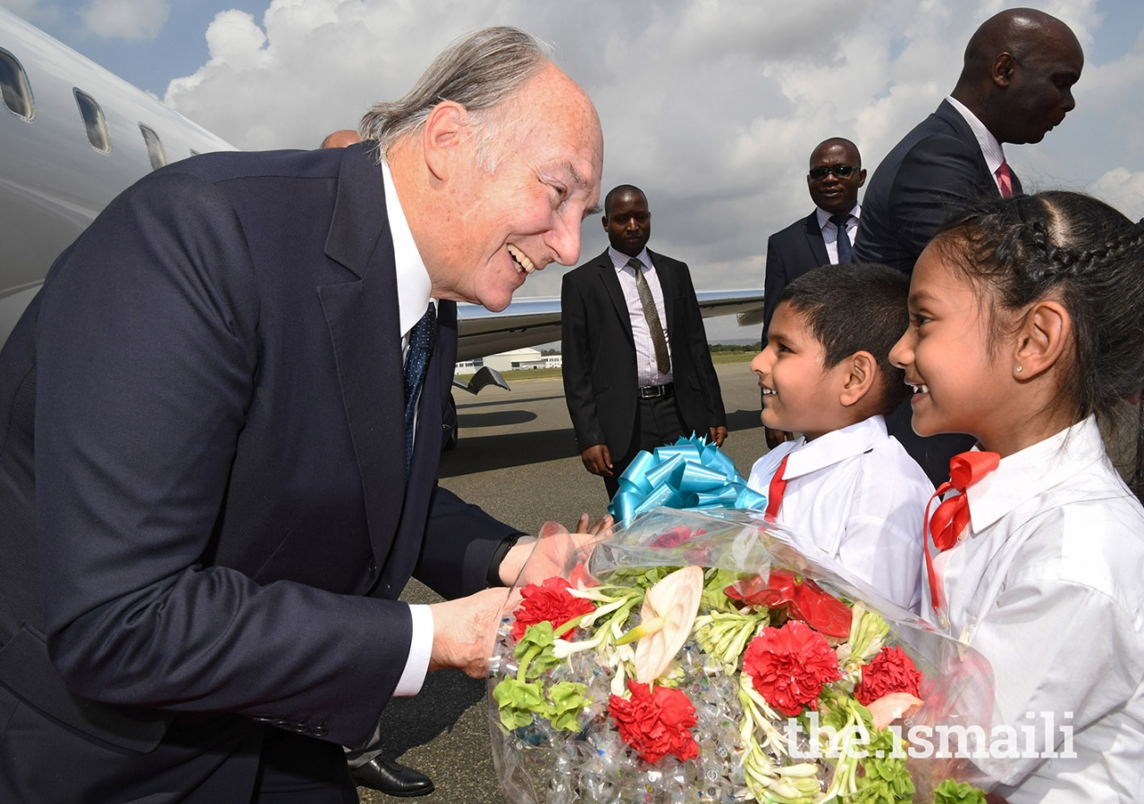 Mawlana Hazar Imam greeted upon his arrival by Junior Volunteers in the Ismaili Volunteers Corps from Tanzania.