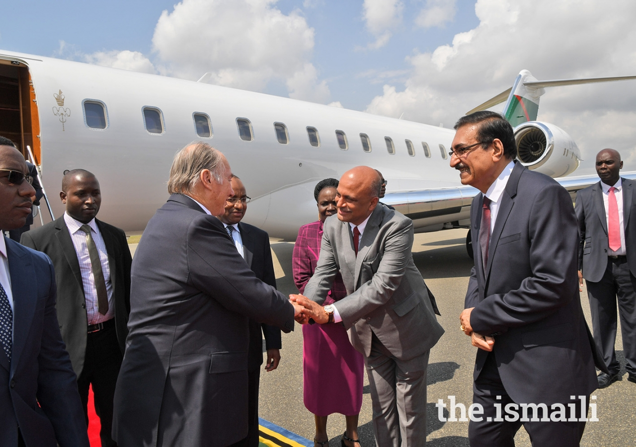 Mawlana Hazar Imam is greeted by Amin Lakhani President of the Ismaili Council for Tanzania.