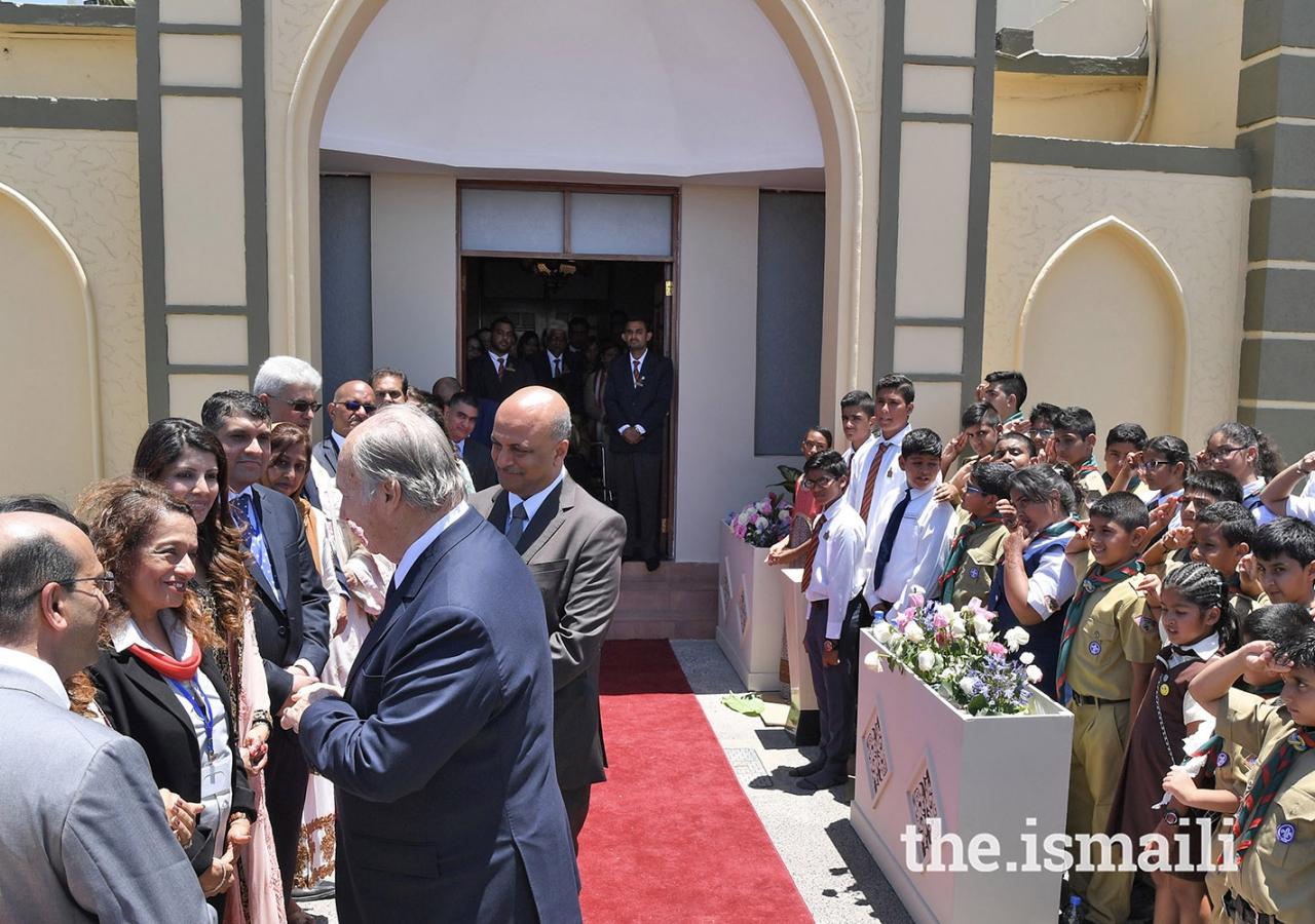 Mawlana Hazar Imam speaks to Jamati leaders, before departing from the Diamond Jubilee Hall.