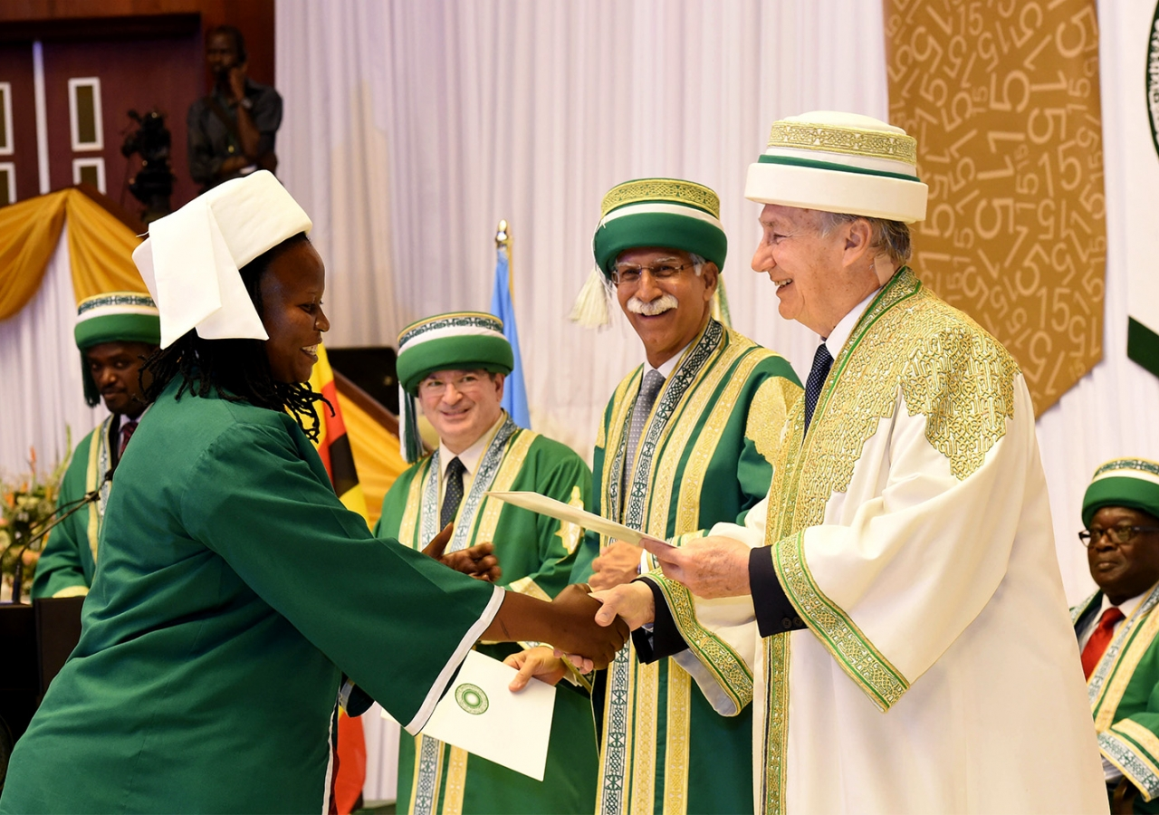 A graduand receives her degree from the Chancellor of the Aga Khan University, at the 2015 convocation ceremony in Kampala. AKDN / Zahur Ramji