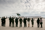 Jamati and institutional leaders wave good-bye as Mawlana Hazar Imam's plane prepares to depart, Mo Govindji