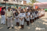 Local school children and Aga Khan Health Board volunteers armed with placards and slogans for Oral Cancer awareness.