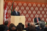 Mawlana Hazar Imam speaks at the opening of the Ismaili Centre, Toronto, as the Canadian Prime Minister looks on. Gary Otte