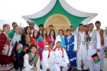 Athletes from several countries gather for a photograph following the Opening Ceremony of the Golden Jubilee Games.