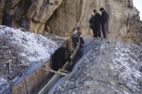 In high mountain areas of Badakhshan,Tajikistan, FOCUS works with local communities to build irrigation channels, pathways, and other structural mitigation projects to protect communities from the effects of avalanches, flooding, mud slides and rock falls