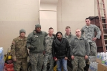 Sunny Taj with members of the Michigan National Guard, assisting in distributing clean water to the citizens of Flint, Michigan.
