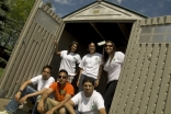 Edmonton youth pose outside one of the sheds they built in partnership with Habitat for Humanity.