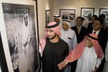 His Highness Sheikh Majid and Noor Ali Rashid  pause at a photograph of the late Ruler of Abu Dhabi, Sheikh Zayed Bin Sultan Al Nahyan.