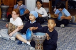School children learn to play the daf, an Iranian percussion instrument.