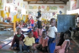 Children prepare for snack time at an AKF Madrasa Programme preschool in Uganda.