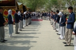 Volunteers line up to welcome Jamati and institutional leaders at Umomi Jamatkhana at the conclusion of Volunteer Week in Afghanistan.