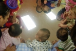 Little toddlers meet and make friends on the first day of school.