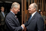 Mawlana Hazar Imam greets His Royal Highness the Prince of Wales at the Ismaili Centre, London. The Prince's visit to the Centre commemorates its 25th anniversary.