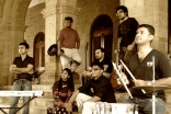 Members of the Salimahabad Orchestra. From left to right: Amirali Meghani, Naveed Rajput, Sadaf Faiz, Asif Noorani, Rahim Sundrani, Sohail Noorani, and Rafiq Vadivala.