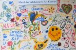 The Ismaili Council's Art for Alzheimer's canvas includes notes from many supporters, including the First Lady of California, Maria Shriver.