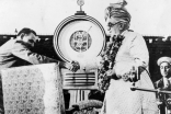 Mawlana Sultan Mahomed Shah about to be weighed in diamonds in celebration of the 60th year of his Imamate at the Brabourne Stadium in Bombay, 10 March 1946.