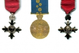 Medallions of the Most Excellent Order of the British Empire and the Medal of the Order of Australia.