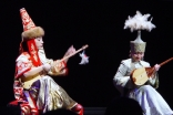 Ulzhan Baibussynova and Ardak Issataeva play the dombra and sing traditional Kazakh songs