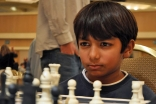 Danial Asaria plays an intense game at a national US chess championship.