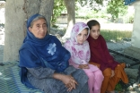 Sultan Bibi from Uchushti village in Chitral, Khyber Pakhtunkhwa is seen sitting with village girls. She survived the floods but lost her 25-year-old son and 19-year-old daughter to the raging waters.