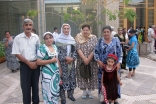 Jamati members pose for an Eid photograph in the courtyard of the Ismaili Centre, Dushanbe.