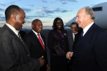 Mawlana Hazar Imam is welcomed to Arusha by the Deputy Secretaries General of the East African Community.
