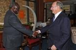 The President of Kenya, His Excellency Mwai Kibaki, greets Mawlana Hazar Imam at the Jomo Kenyatta International Airport in Nairobi.