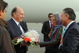 Mawlana Hazar Imam is presented with a bouquet of flowers by AKDN Resident Representative Nurjehan Mawani upon his arrival in Kabul, as Ismaili Council for Afghanistan President Shair Baz Hakemy looks on.
