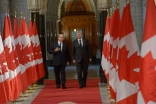 Mawlana Hazar Imam and Prime Minister Stephen Harper walk the Hall of Honour at the Parliament of Canada.
