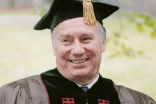 Mawlana Hazar Imam dressed in Brown University regalia in May 1996.