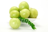 Amla (Indian gooseberry) is a tangy seasonal fruit that is high in vitamin C.