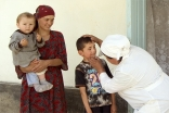 A child receives a check-up at an AKHS medical point managed by a midwife and two nurses in Shidz, Gorno-Badakhshan Autonomous Oblast.