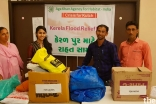 Volunteers in Kutch assisting in the collection of flood relief items
