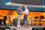"Zameer Rayani receiving the ""Just Do It Award' from Amazon CEO Jeff Bezos."