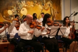 Members of the Royal Philharmonic Orchestra perform with the Ismaili Community Ensemble.