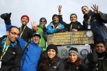 FOCUS Challenge4Life 2013 participants celebrate reaching the summit of Mount Kinabalu, before journeying on by foot, bicycle and raft to the South China Sea. Alnasir Jamal