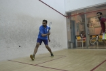 Youth playing a game of squash