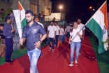 Athletes bearing the Indian flag follow the Jubilee Games Fanous at a ceremony in Mumbai. Shams Maredia