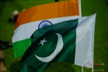 The flags of India and Pakistan wave in the breeze in the early hours of the morning. JG/Mairaj Amir