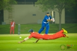 Team India (red) tries to save a boundary hit by Team Pakistan (blue). JG/Mairaj Manji
