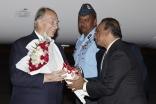 Ismaili Council President Gulam Rahimtoola welcomes Mawlana Hazar Imam with a bouquet of flowers on behalf of the India Jamat. Aziz Ajaney