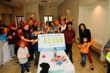 Volunteers of all ages celebrate as they exceed the goal of packing 60,000 meals in celebration of 60 years of Imamat.