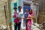 a_family_of_four_with_their_new_toilet._the_introduction_of_toilets_has_made_a_substantial_difference_to_community_health_outcomes_in_areas_where_akahi_has_implemented_its_environmental_health_improvement_programme