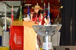 President Lalani-Khudabux glows aside the Games' torch. Credit: Ismaili Council for BC