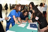 Members of the medical team were among the thousands of volunteers who cared for the Jamat during the July 11 celebration at the Kay Bailey Hutchison Convention Center in Dallas.