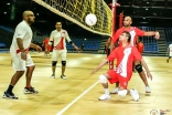 Team UK (red) competes against Team Canada (white) in a traditional volleyball match. JG/Asif Balesha