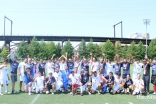 Joint team picture taken in the spirit of unity and brotherhood after a hard fought soccer final between Richmond (white) and New York (blue).