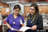 AKU nurses Salima Pirani (Dallas) and Amina Huda (California) review patient records during their volunteer shift.