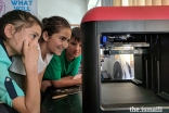 Students watch as the first 3D printer in all of Badakhshan province begins to print a model.